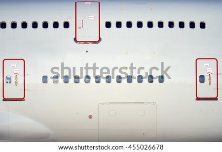 Large heavy modern passenger widebody airplane stock photo 455026678 shutterstock for Exterior emergency exit lights