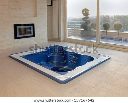Large hot tub built in flor of room interior - stock photo