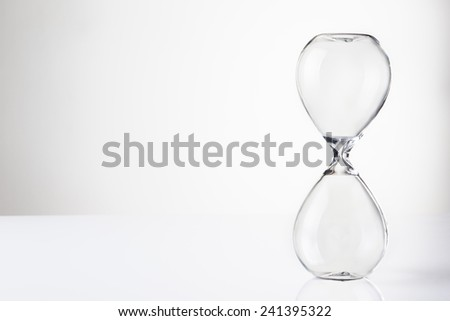 large hour glass sand timer with no sand in there - stock photo