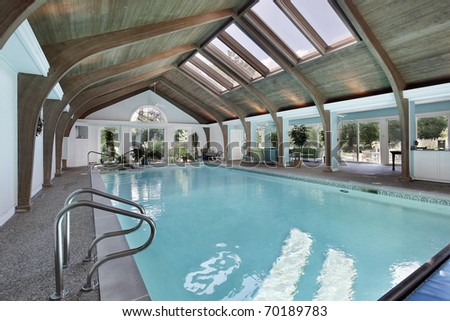 Large indoor swimming pool with six skylights