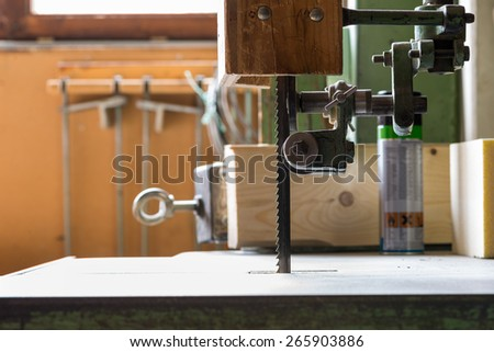 large industrial band saw of carpentry with table and rolls - stock photo