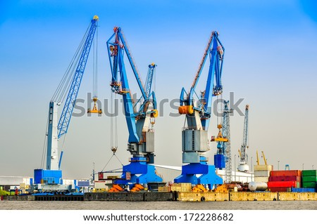 Large industrial cargo cranes in the sea harbor - stock photo