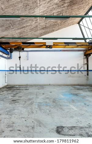 Large industrial garage abandoned, interior - stock photo