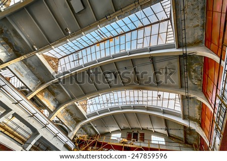 Large industrial hall with low light angle shot