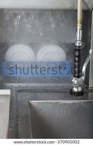 large industrial kitchen dishwasher and sink all stainless steel