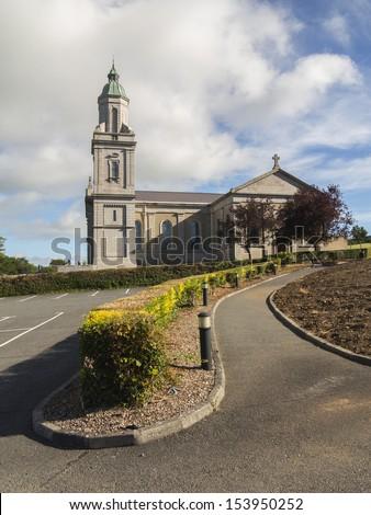 large irish church with cross and steeple - stock photo