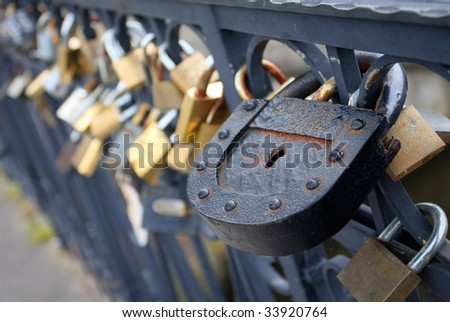 Large iron lock on a bridge - stock photo