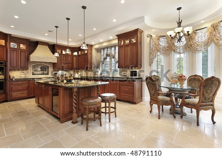 Large kitchen in luxury home with eating area - stock photo