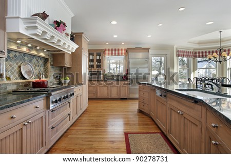 Large kitchen in modern home with eating area