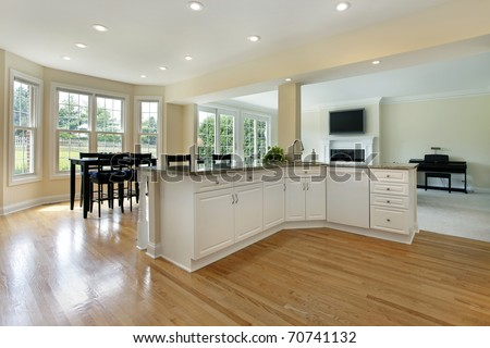 Large kitchen in remodeled home with eating area - stock photo