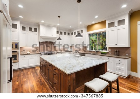 kitchen in luxury home with oak cabinets stock photo   Large Kitchen Interior Island Sink White Stock Photo ...