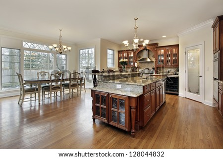 Large kitchen with island and eating area - stock photo