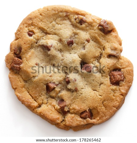 Large light chocolate chip cookie on a white surface shot from above - stock photo