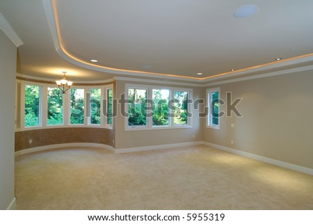 large luxurious unfurnished room with lots of upgrade - stock photo