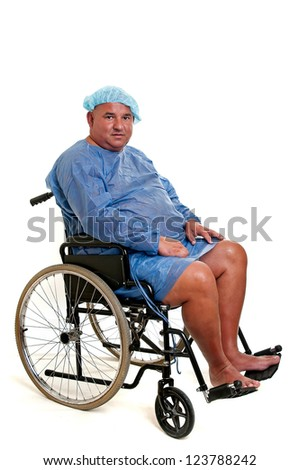 Large male patient in a wheelchair - stock photo