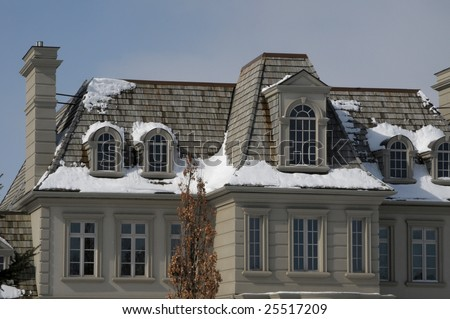 Large mansion with cedar shake roof