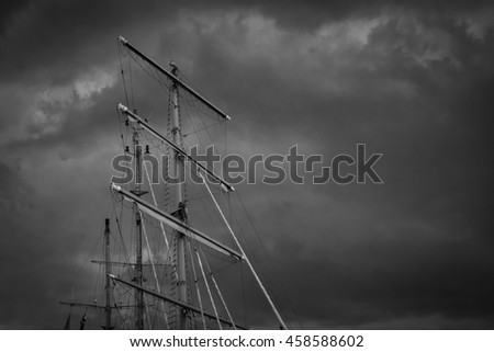 Large mast of an old sailing ship in black and white - stock photo