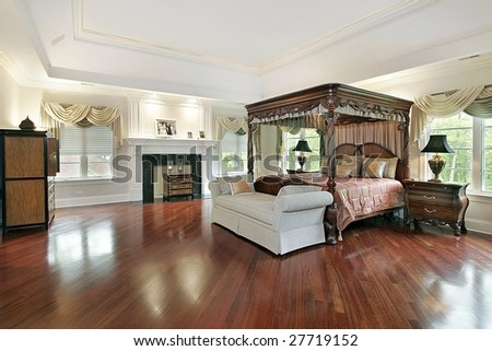 Large master bedroom with fireplace - stock photo