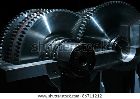 Large Metal gears on black background - stock photo