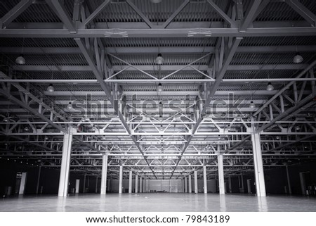 Large modern dark  empty storehouse - stock photo