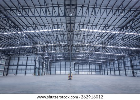 Large modern empty storehouse with safety equipment - stock photo