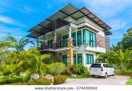 Large modern house with the car in the courtyard - stock photo