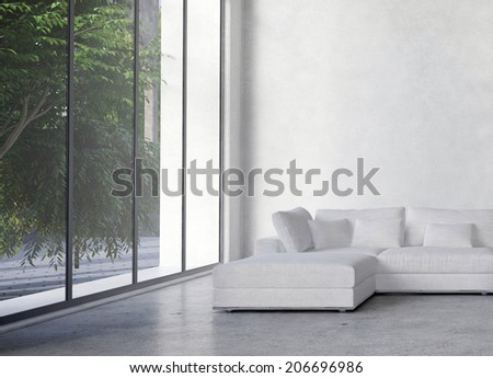 Large modern minimalist living room interior with a double volume ceiling and large glass window overlooking trees - stock photo