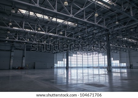 Large modern storehouse with window at wall - stock photo