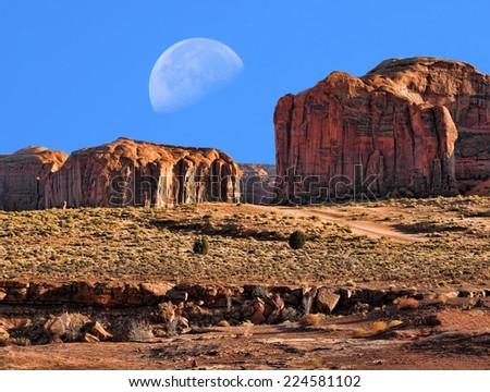 Large moon over Monument Valley Arizona - stock photo