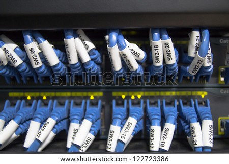 Large network hub and connected Internet cables - stock photo
