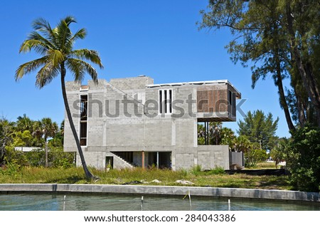 Large New Beach House under Construction on Waterway - stock photo