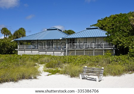 Large New Beach House with Blue Tin Roof and Storm Shutters  - stock photo