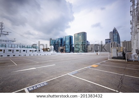 large numbered space parking lot  - stock photo