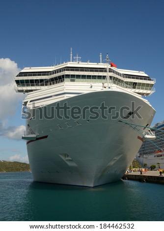 Large ocean liner in dock front closeup view - stock photo