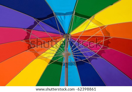 large, open multicolor umbrella, seen from below - stock photo