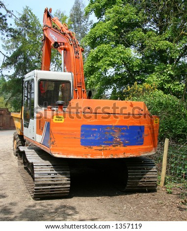 Large orange Mechanical digger - stock photo