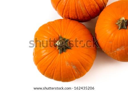 Large orange pumpkins on a white background. - stock photo