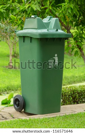 Large outdoor green garbage bin in a park - stock photo