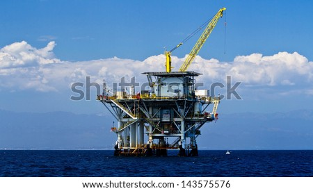 Large Pacific Ocean offshore oil rig drilling platform off the southern coast of California, between Ventura and the Channel Islands - stock photo