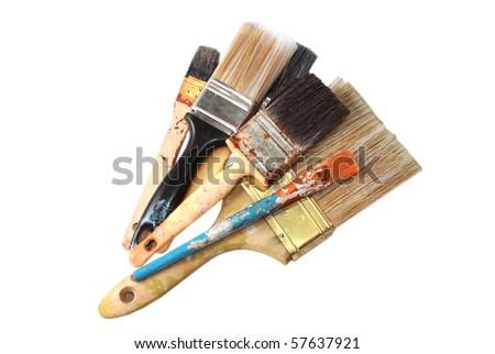 Large paint brushes isolated on white - stock photo