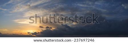 Large panorama image of stormy sunset sky - stock photo