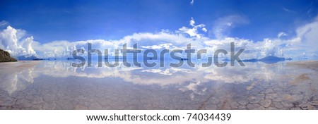 large Panorama of reflective salt-flats in Bolivia - stock photo