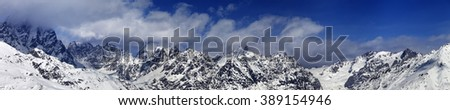 Large panoramic view on snowy mountains in haze at sunny day. Caucasus Mountains. Svaneti region of Georgia. - stock photo