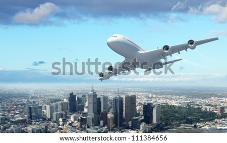 Large passenger airplane against blue sky and city - stock photo