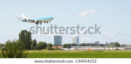 Large passenger jet making its landing approach - stock photo
