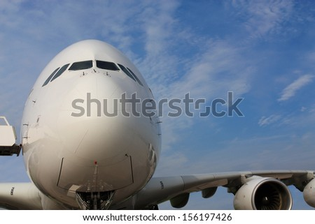 Large passenger jet with the oversight of a ladder, front view - stock photo