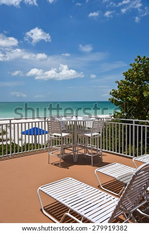 Large Patio overlooking beach on the Gulf of Mexico - stock photo