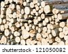 Large pile of cut wooden logs for renewable energy. - stock photo