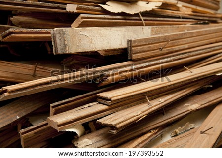 Large pile of hardwood floor being ripped out at an apartment during construction