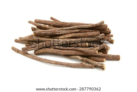 Large pile of liquorice root sticks, isolated on a white background - stock photo